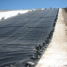 Landfill covered with plastic sheets